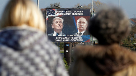 A billboard showing a pictures of US president-elect Donald Trump and Russian President Vladimir Putin is seen through pedestrians in Danilovgrad, Montenegro, November 16, 2016. © Stevo Vasiljevic