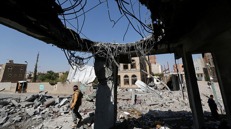 FILE PHOTO: A man stands at the site of Saudi-led air strikes that destroyed several houses in Yemen's capital Sanaa September 17, 2015 © Khaled Abdullah