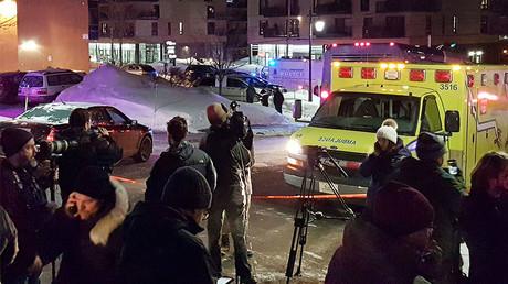 An ambulance is parked near a mosque after a shooting in Quebec City. © Mathieu Belanger