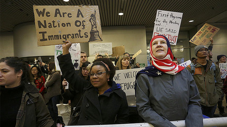 Activists gather at Portland International Airport as part of nationwide protests against President Donald Trump's executive action travel ban. © Steve Dipaola