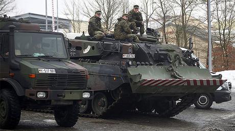 German armed forces Bundeswehr soldiers sit on a Bueffel (