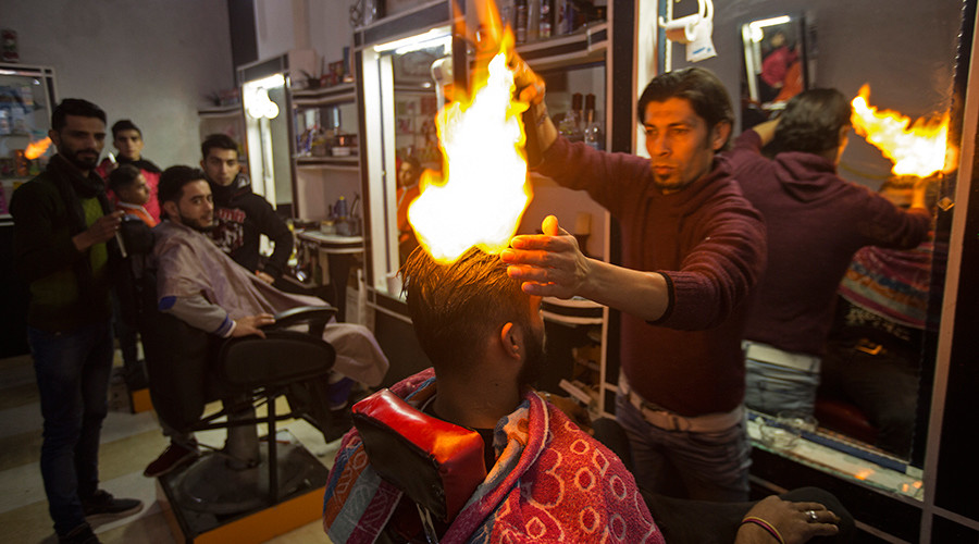 Meet Gaza's hottest barber: Palestinian uses fire to style hair (VIDEO)