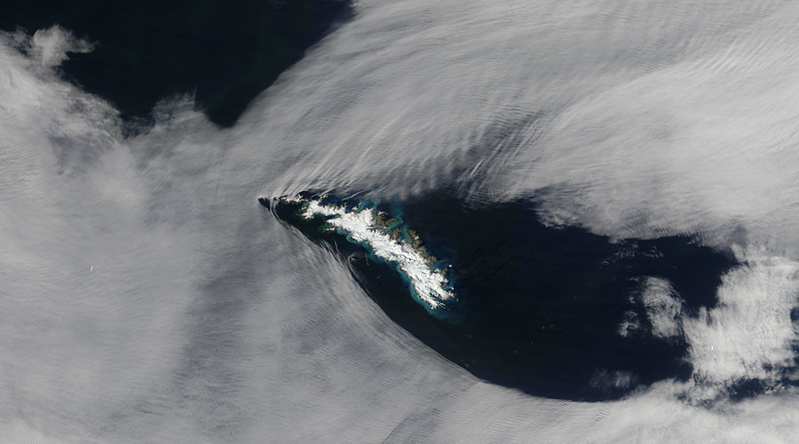 Mesmerizing NASA image shows clouds carved up by 'gravity waves' (PHOTO)