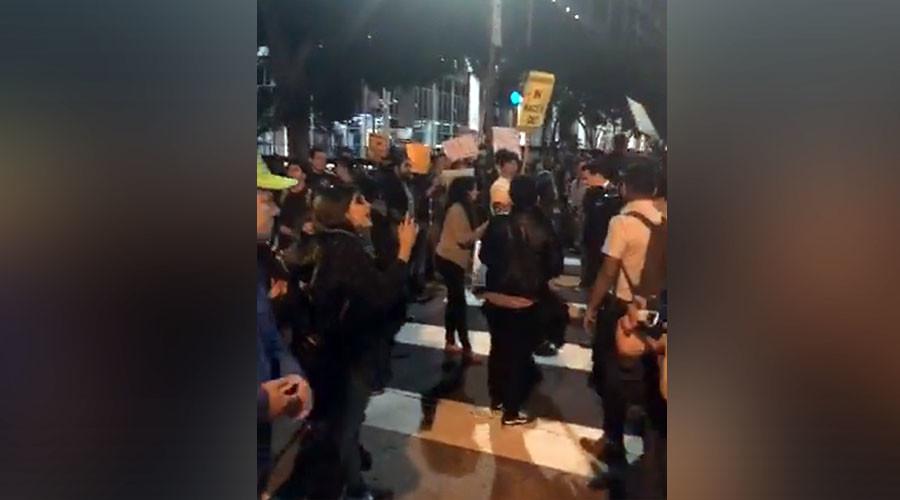 'Racists out!' Demonstrators block LA street to protest immigration raids (PHOTOS)