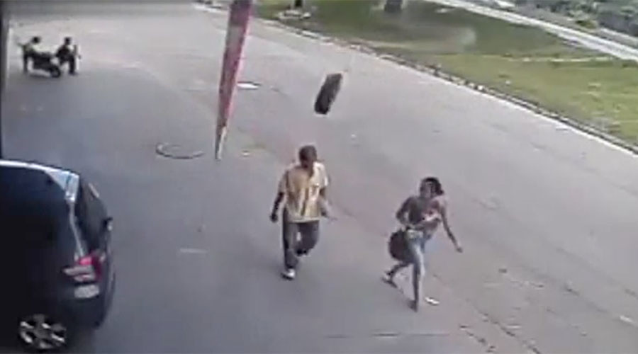 Freak runaway tire slams pedestrian into pavement (VIDEO)