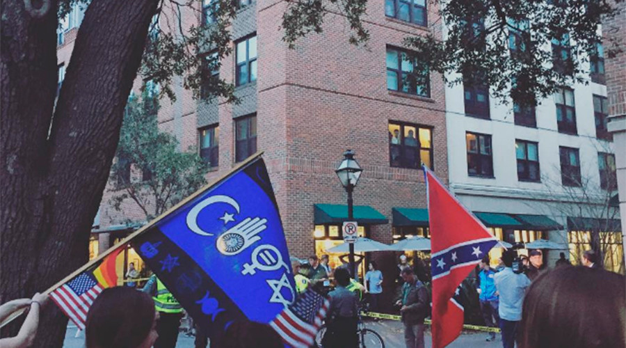 Dramatic footage shows BLM activist tear down Confederate flag on live TV & get arrested (VIDEO)