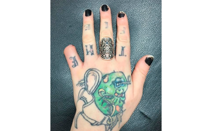 Tattoo artist cuts off her own little finger with bolt for Cut off tattoo