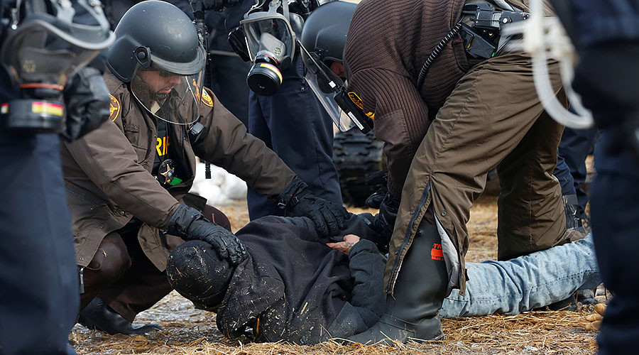 Police & military clear DAPL protest camp, dozens arrested, protesters start fires (PHOTOS)