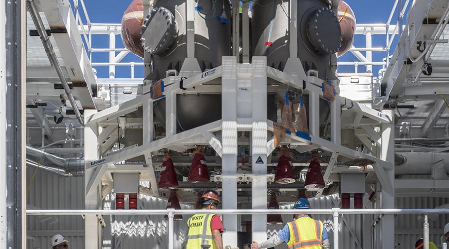 NASA weighs risks of adding crew to Orion spacecraft's maiden moon flight