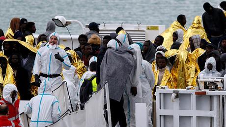 Migrants wait to disembark from Italian Coast Guard patrol vessel Diciotti in the Sicilian harbour of Catania, Italy, January 28, 2017. © Antonio Parrinello