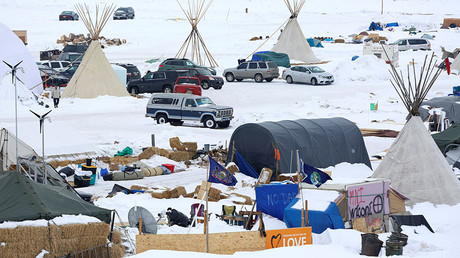 Signs hang in the Dakota Access Pipeline protest camp on the edge of the Standing Rock Sioux Reservation near Cannon Ball, North Dakota, U.S., January 24, 2017. © Terray Sylvester