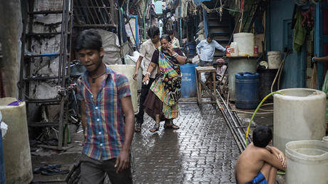Residents walk in an alley in Dharavi, one of Asia's largest slums, in Mumbai © Danish Siddiqui