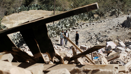 People look at a house destroyed by a Saudi-led air strike in Sanaa © Mohamed al-Sayaghi