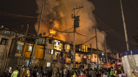Huge blaze ravages slum in Philippines capital, leaves 15,000 homeless