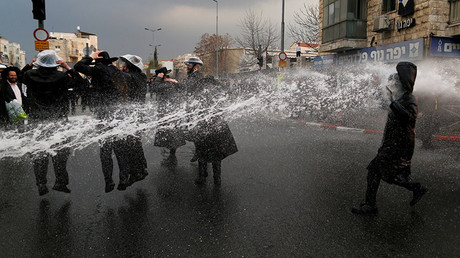 Ultra-Orthodox Jewish protestors are sprayed with water by Israeli police in Jerusalem February 9, 2017. © Ammar Awad
