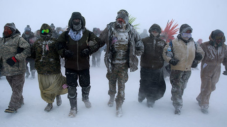 Veterans march with activists outside the Oceti Sakowin camp in December © Stephen Yang