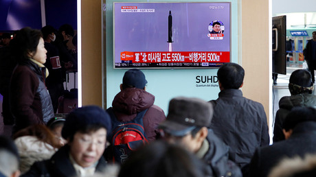 South Koreans watch news report on North Korean missile launch, Seoul, February 12, 2017
