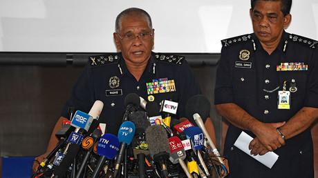 Malaysia's deputy national police chief, Noor Rashid Ibrahim (left), speaks during a press conference. © Mohd Rasfan