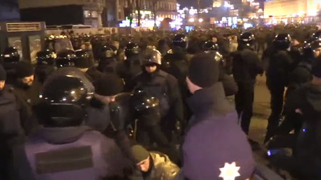 Scuffles erupt between police and protesters in downtown Kiev during Maidan anniversary rally