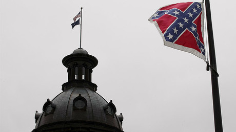 A Confederate flag flies in front of the South Carolina State House in Columbia, South Carolina (FILE PHOTO). © Tami Chappell