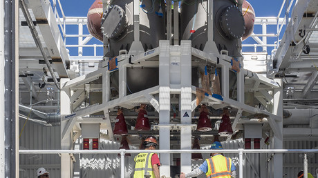 NASA weighs risks of adding crew to Orion spacecraft's maiden moon flight