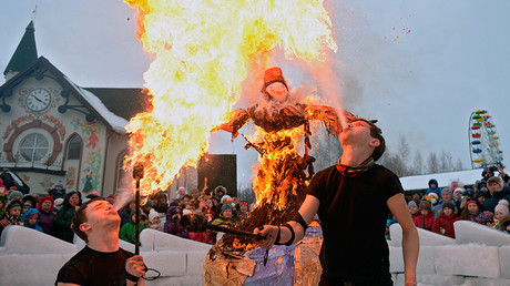 Ritual bonfires and fist fights as Russians celebrate Maslenitsa