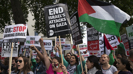 FILE PHOTO: Pro-Palestinian protesters chant during a demonstration against violence in the Gaza, London. © Neil Hall
