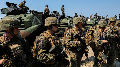 U.S. Marines stand in front of amphibious assault vehicles (AAV) © Athit Perawongmetha
