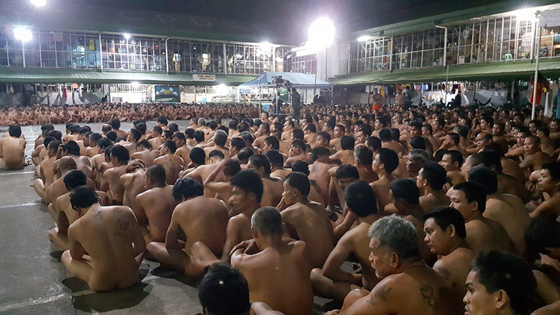 Images of Philippines prisoners sitting naked in