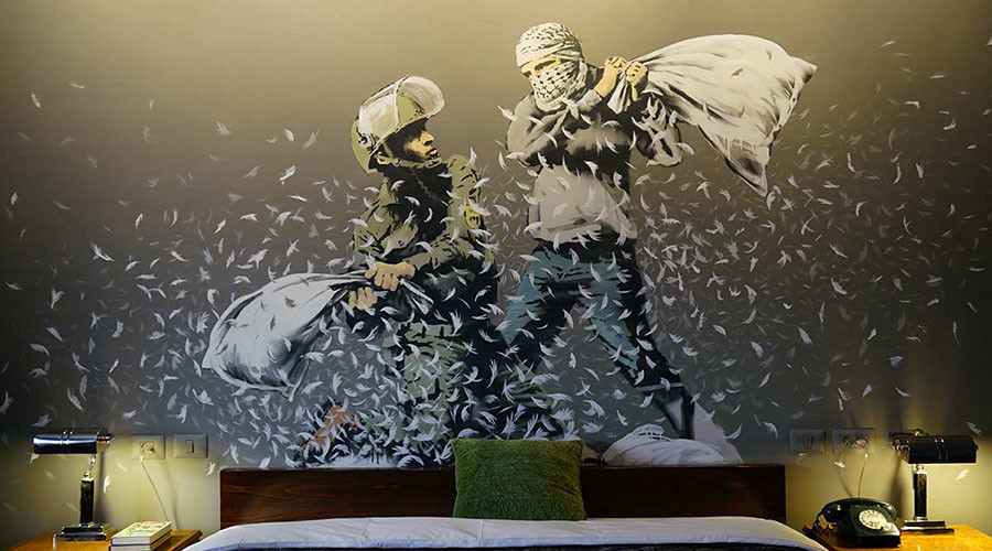 Banksy's Bethlehem hotel offers room with a view of West Bank barrier (PHOTOS)
