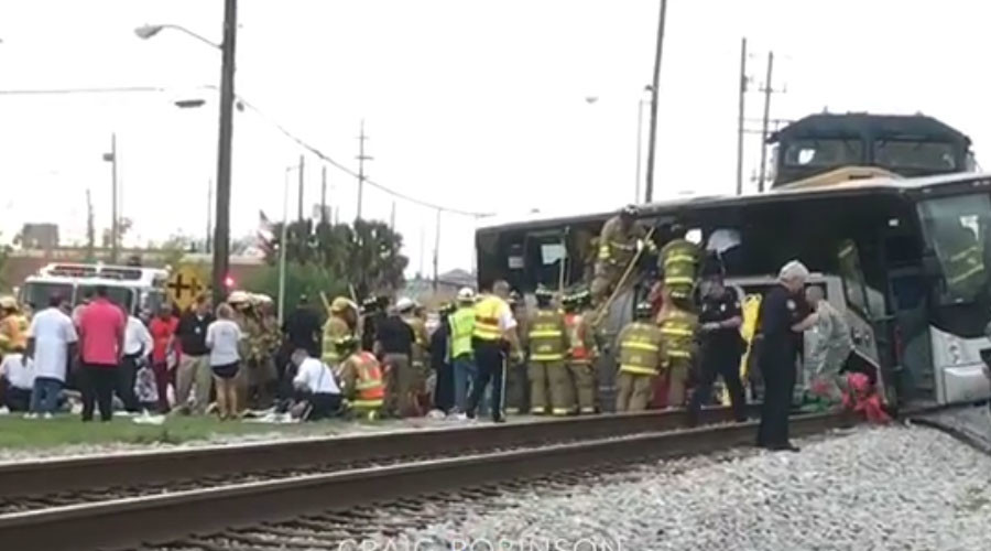 Train slams into charter bus in Biloxi - 3 dead, dozens injured