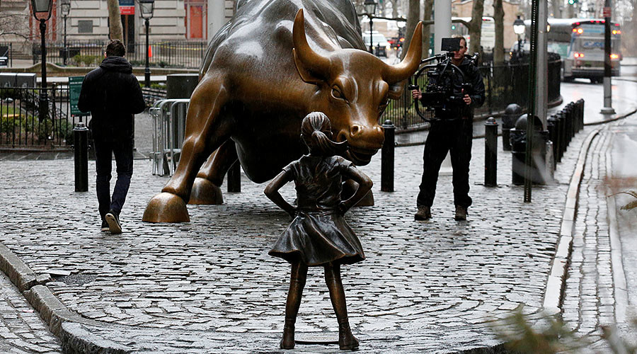 Life-size statue of girl stares down Wall Street's bull on Women's Day