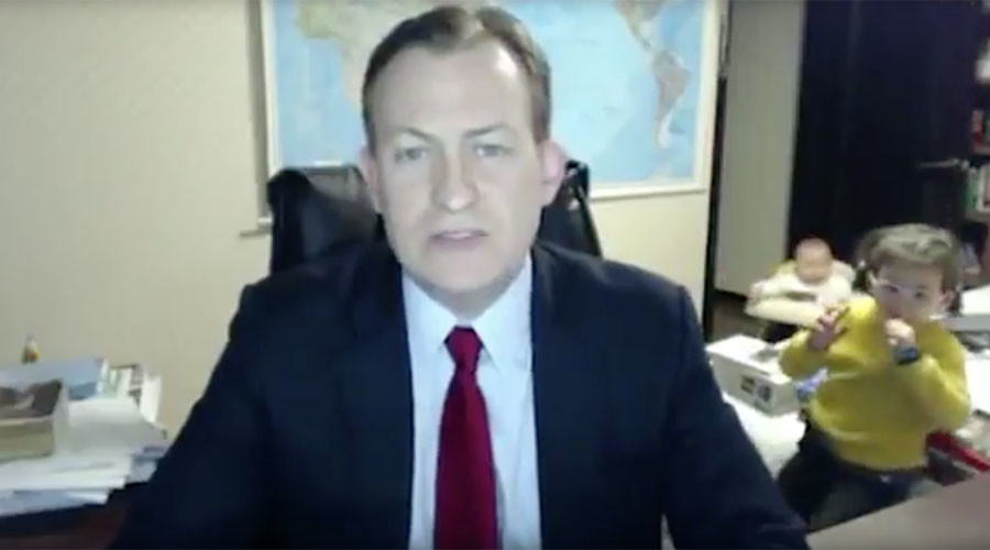 Curious kids gatecrash BBC news pundit's live interview with perfect comic timing (VIDEO)