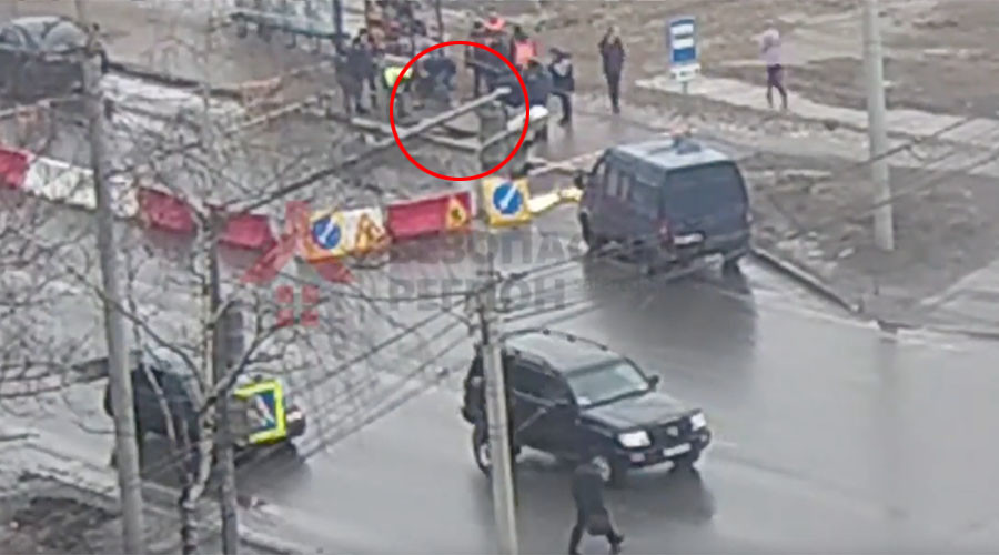 Russian road swallows man waiting for trolleybus (VIDEO)