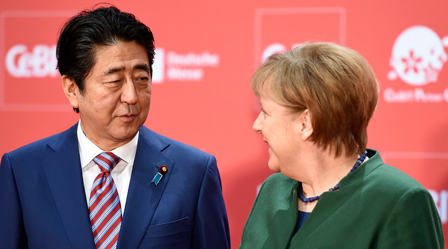 Merkel, Abe defend globalization, calling for EU-Japan trade agreement