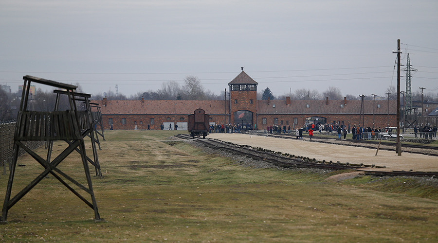 Bizarre Auschwitz death camp protest sees naked protesters slaughter sheep & chain themselves up