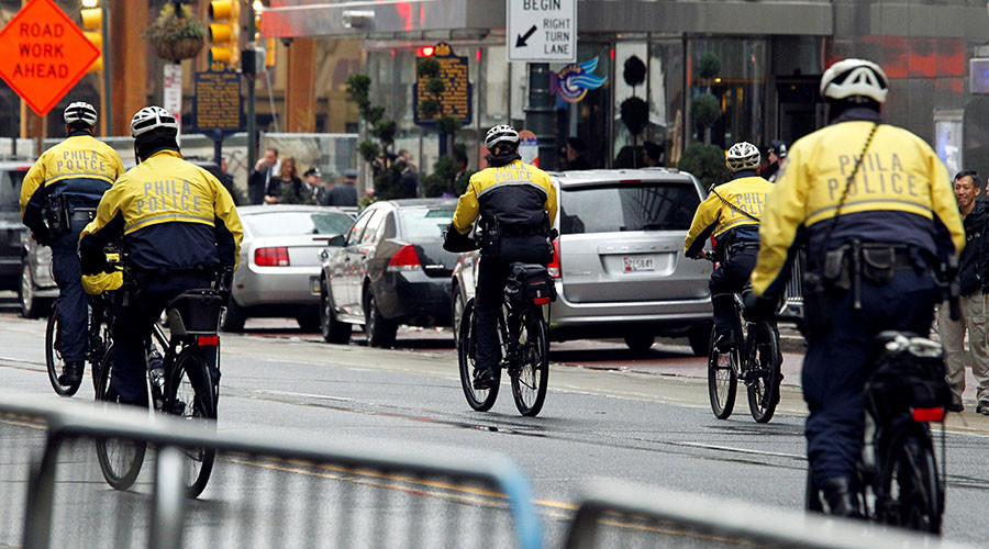 Philadelphia Police investigating officer for swinging bike at protester