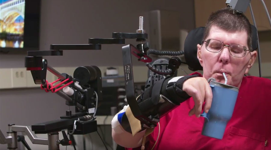 Brain power: Paralyzed man uses thoughts to move arm & hands (VIDEO)