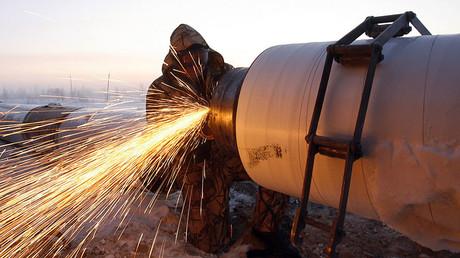 A Gazprom worker welds a part of a pipeline ©Denis Sinyakov