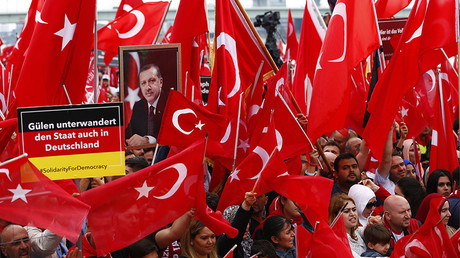 FILE PHOTO Supporters of Turkish President Erdogan wave Turkish flags during a pro-government protest in Cologne © Thilo Schmuelgen / Reuters