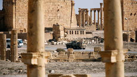 A military vehicle drives near ruins in the historic city of Palmyra, Syria March 4, 2017. © Omar Sanadiki