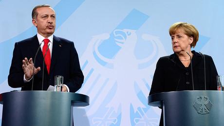Turkish Prime Minister Recep Tayyip Erdogan (L) and German Chancellor Angela Merkel. ©John Macdugall