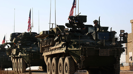 A convoy of US forces armoured vehicles drives near the village of Yalanli, on the western outskirts of the northern Syrian city of Manbij, on March 5, 2017 © Delil Souleiman