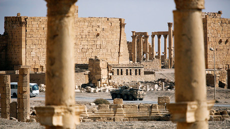 A Russian military vehicle drives near ruins in the historic city of Palmyra, Syria March 4, 2017. © Omar Sanadiki