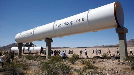 Journalists and guests look over tubes following a propulsion open-air test at Hyperloop One in North Las Vegas, Nevada, U.S. May 11, 2016. © Steve Marcus