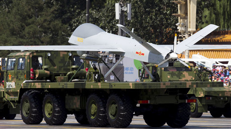 Military vehicles carrying Wing Loong, a Chinese-made medium altitude long endurance unmanned aerial vehicle, Sept. 3, 2015 © Andy Wong