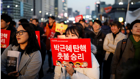People attend a rally calling for impeached President Park Geun-hye's arrest in central Seoul, South Korea, March 10, 2017. © Kim Hong-Ji