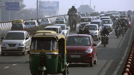 People ride an elephant amid heavy traffic on a busy road during rush hour in New Delhi ©Parivartan Sharma