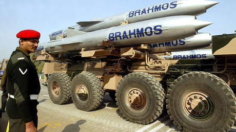 FILE PHOTO: An Indian soldier stands guard near a truck mounted with Brahmos cruise missiles © Kamal Kishore
