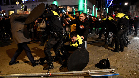 Riot police clash with demonstrators in the streets near the Turkish consulate in Rotterdam © Dylan Martinez / Reuters